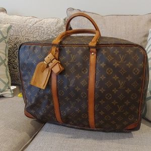 06b62d0a9627 Louis Vuitton
